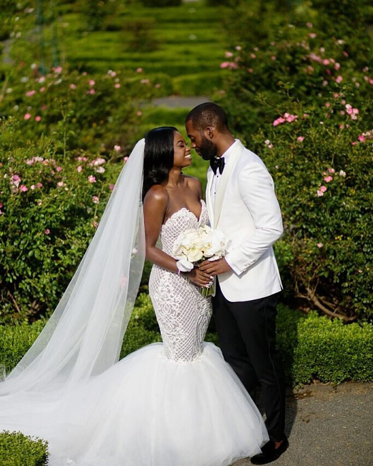 Sneak peek! Absolutely stunning photo of @shaq_will and her hubby. Congrats and we wish you two the absolute best of marriage. Enjoy your honeymoon!   Photo - @Bypetronella // Bridal Fashion Styling and Wedding Coordination - @vaingloriousbrides // Dress- @jeanralphthurin // Suit -@mr_andre_clarke_womack // Bow tie - @TomFord // Hair - @nicky_b_on_hair // Makeup - @irobincredible // bouquet - @divablooms #munacoterie #justmarried #weddings #love #weddinggown #munafashion