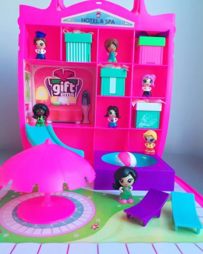 The Gift'ems Hotel and Spa is a cute playset that comes with a slide, pool, beach ball, umbrella and even pool chairs! It includes one lifeguard doll and doubles as a storage case (everything fits nicely inside).
