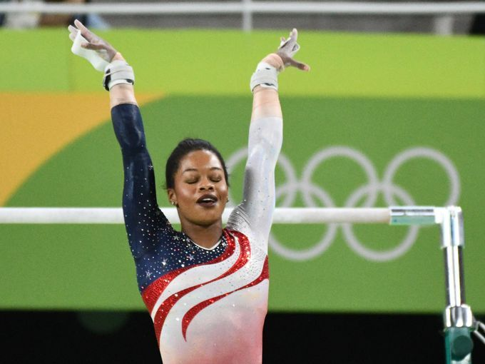 Gabby Douglas (USA) competes during the women's team