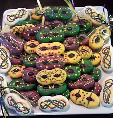 """Mardi Gras Nutter Butter Cookies"" -- These are gorgeous! Click through for photo tutorial for these masks and beads."