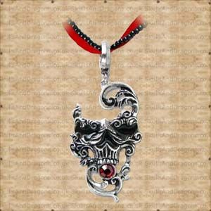 Reflecting elaborate C.16th maschera style, the grotesquely Baroque face of death. A gothic skull with a red swarovski crystal. Together with a double chain of black beads and red ribbon. An exquisite piece of gothic jewellery. The Venetian Mask of Death by Alchemy Gothic jewellery in the Skulls and Dragons Necklace range.    Height : 6 cm    Width : 1 cm    Length : 4 cm    Made from pewter    Ref : SDP591   Price : 34.99 GBP