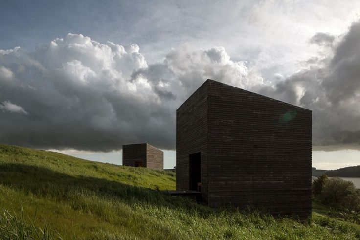 Cheshire architects embeds monolithic eyrie cabins into for Landscape architecture new zealand