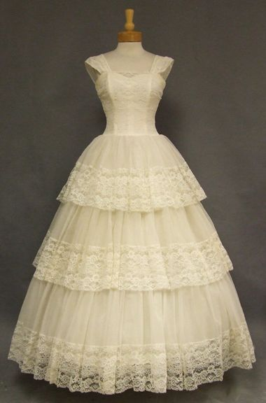 1960s wedding gown in ivory nylon chiffon and lace. Fitted, heart shaped bodice with wide straps.