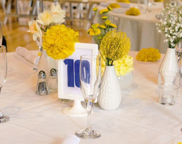 simple yellow flower centerpieces and Ikea Tolsby Table Numbers