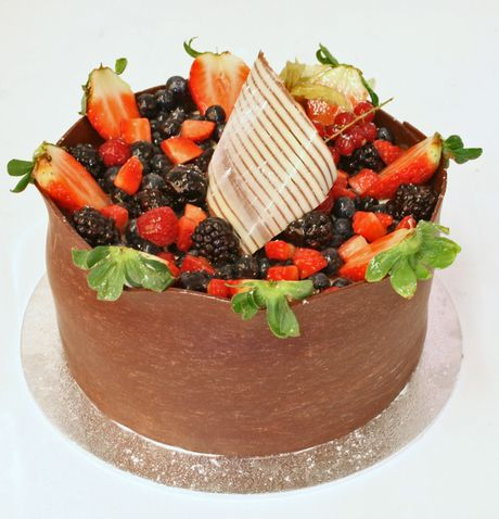 Gateau Beaubourg: The light, moist chocolate sponge is split with delicious chocolate ganache and decorated in a handmade chocolate casing to the sides and chocolate curl on top. The cake is topped with market fresh red fruits. It really does taste as light and delicious as it looks.