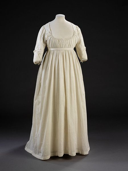 Gown        Place of origin:        Great Britain, UK (made)      Date:        1797-1805 (made)      Artist/Maker:        unknown (production)      Materials and Techniques:        Cotton, linen, linen thread and tape; machine-woven and hand-sewn      Credit Line:        Given by Messrs Harrods      Museum number:        T.820-1913      Gallery location:        Fashion, room 40