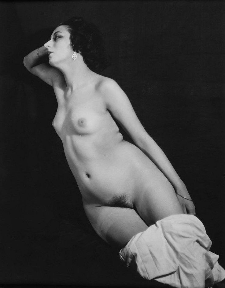 Man Ray (1890-1976) - Kiki de Montparnasse, 1922 Gelatin silver print, printed 1984 by Pierre Gassmann, various credit stamps verso including Man Ray Paris, A.D.A.G.P. and Pierre Gassmann , 28.5 x 22.6cm (11 1/4 x 8 7/8in)