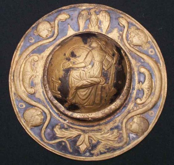 Roman shield boss umbo with an eagle, two serpents, four winds and a goddess in the middle for decoration, 2nd ecntury A.D.