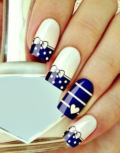 Perfect summer nails - white & blue with dots, heart and bow. See the 10 stunning nail ideas for the summer >>> http://justbestylish.com/10-tips-for-the-stunning-summer-nails/