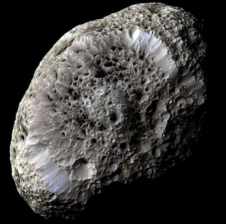 2011 Feb. 27 - Saturn's Hyperion: A Moon with Odd Craters. The robot Cassini spacecraft now orbiting Saturn swooped past the sponge-textured moon in 2005 and 2010 and took images. This image from the 2005 pass, shown in false color, shows a world strewn with strange craters and a generally odd surface. Hyperion is about 250 kilometers across, rotates chaotically, and has a density so low that it might house a vast system of caverns inside.