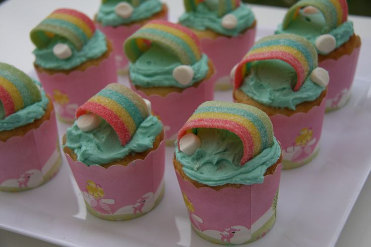 Rainbow cupcakes. Blue buttercream with sour straps as rainbows and mini marshmallows as clouds!