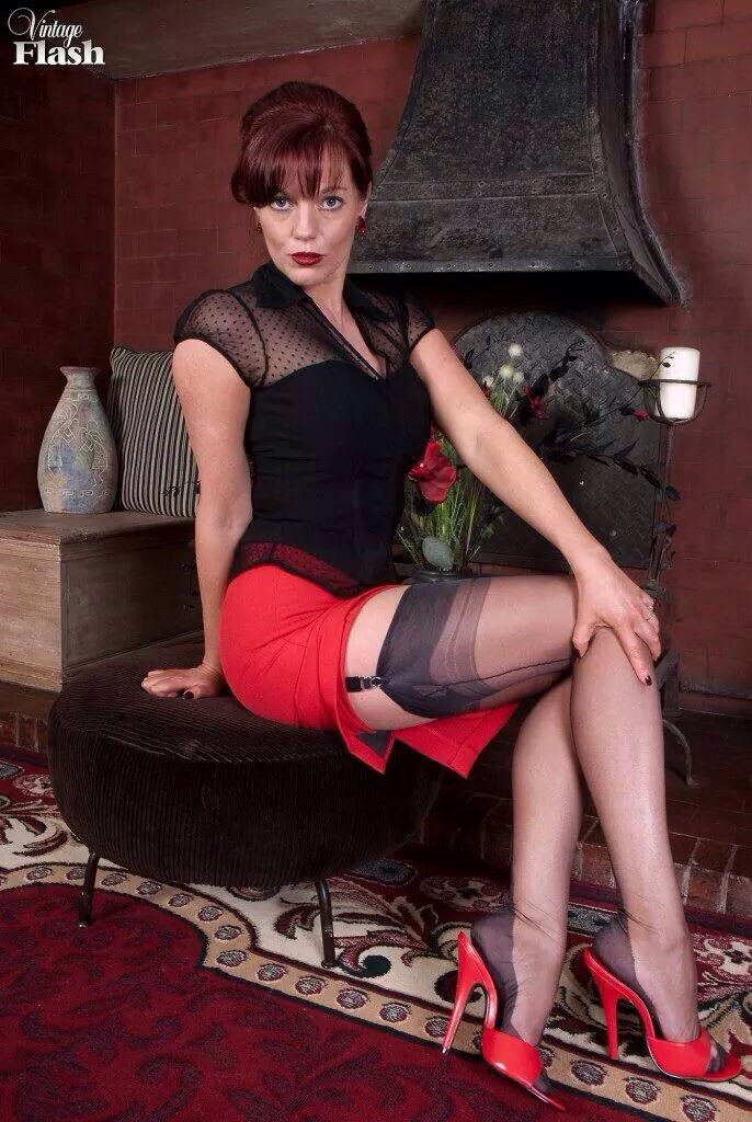 Mature heels and seamed stockings