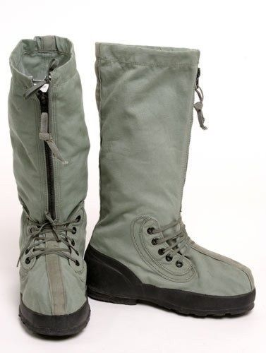 """US Military N-1B ECW Extreme Cold Weather Mukluk Boots  The extreme cold weather boots are commonly called """"Mukluks"""" and make the perfect snow and cold weather boots.  Designed to insulate your feet and keep you warm and protected while standing on snow and ice.   The 10"""" zipper allows easy on and off, and the top has lacing which allows it to be sized to your individual fit.  The rubber bottoms with tread will protect you from water and ice and prevent slipping."""