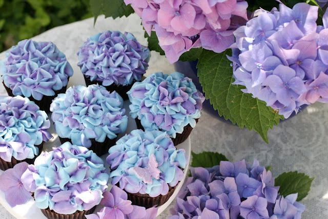Hydrangea Cupcakes - keep frosting on the stiffer side, then use a Wilton 2D closed star tip and two frosting colors