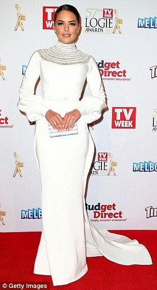 Classy in white: Neighbours star Olympia Valance wore a puffy sleeved J'Aton number for Au...