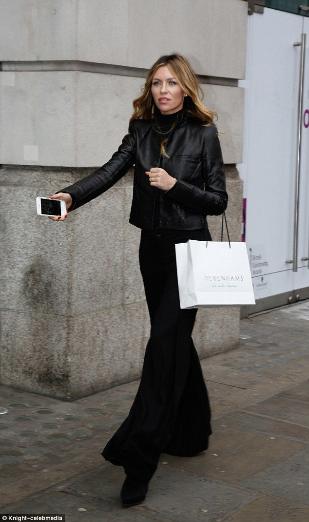 Woman in black: Abbey Clancy, 30, looked fantastic as she attended the Debenhams SS17 even...