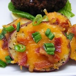 Potato rounds with cheese and bacon...football food!