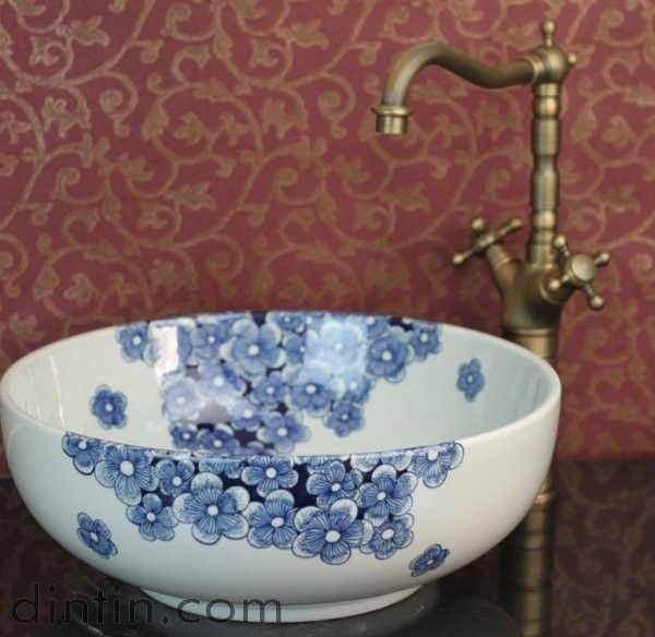 The wallpaper is all wrong, but the chinoiserie blue porcelain sink is amazing.