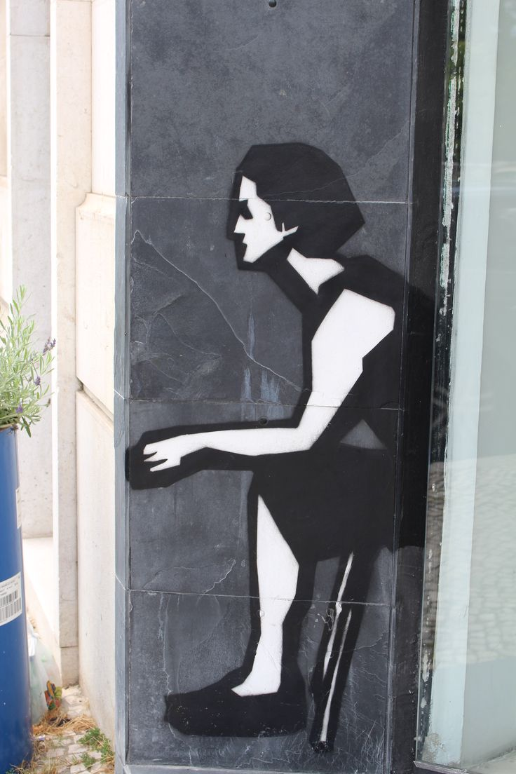 Woman on wall. Lisbon July 2014