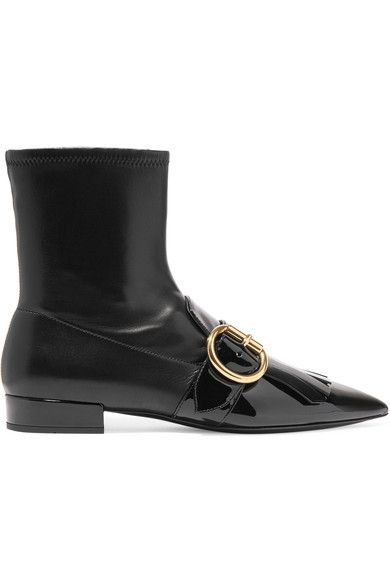 Prada's boots are decorated with loafer-inspired fringing and an oversized gold buckle - a collection signature. Set on a low 20mm heel, this pair has been expertly made in Italy in a silhouette that's designed to fit snugly at the ankle. We especially like the playful combination of patent and smooth black leather.