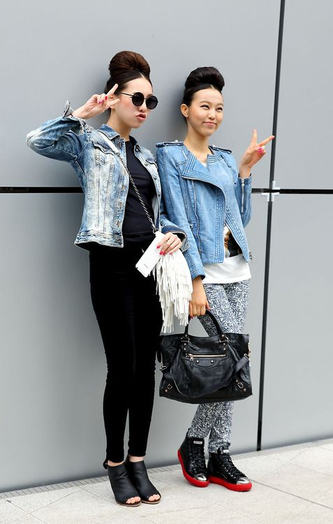 Shop this look for $279:  http://lookastic.com/women/looks/biker-jacket-and-crew-neck-t-shirt-and-high-top-sneakers-and-tote-bag-and-skinny-pants/2507  — Light Blue Denim Biker Jacket  — White Print Crew-neck T-shirt  — Black Leather High Top Sneakers  — Black Leather Tote Bag  — White and Blue Print Skinny Pants