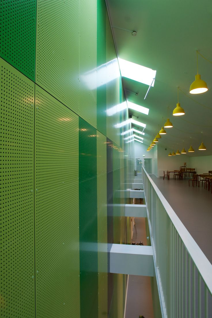 Barsmark Greyston - perforated aluminium composite sheets seen in four shades of green.