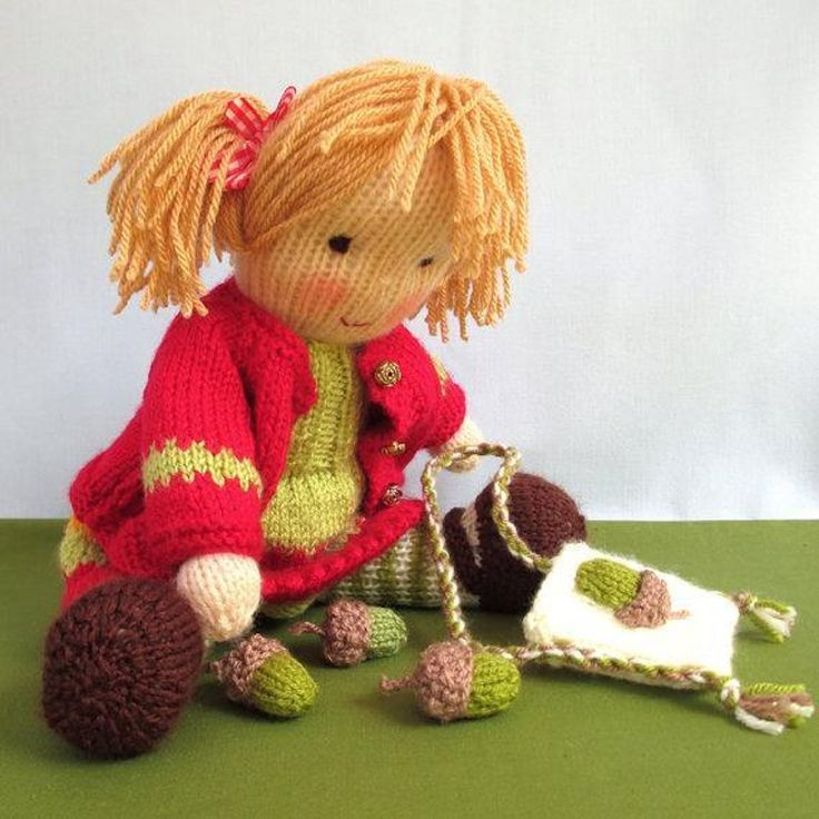 LITTLE NELLIE NUTKINS likes to gather acorns for her squirrel friends and pop them into her bag with an appliqued acorn on the front. She's an absolute sweetheart.PATTERNS INCLUDES: Doll, dress, cardigan and panties (clothes removable),bag and acorns.SIZE: 30cm (12in)NEEDLES: Pair of 3.25mm (US 3) for Little Nellie and 2.75mm (US 2) for acorns.YARN: DK (double knitting) yarn (USA - light-worsted/Australia - 8 ply).SKILLS REQUIRED: Cast on, cast off, knit, purl, increase, decreas...