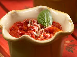 Baked Tomato Casserole  A warm and hearty mixture of marinara sauce, fresh basil and brown sugar rests atop a softened layer of Marzetti's Large Cut Garlic & Butter Croutons.  From Marzetti Kitchens℠.