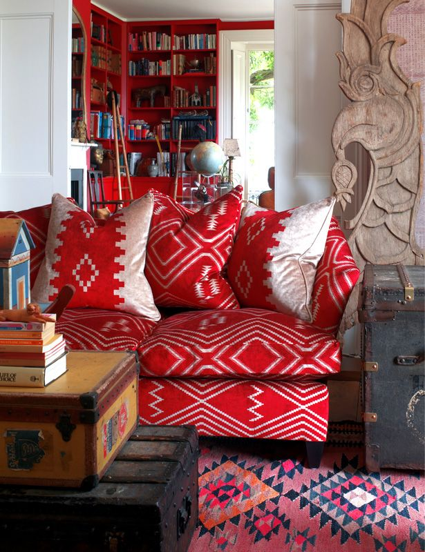 red overstuffed sofa + beautiful red bookcases