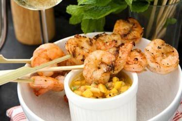 Ginger prawn skewers with banana, chilli and mango salsa
