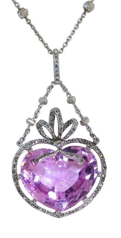 A Belle Epoque platinum, diamond and Imperial pink topaz pendant, circa 1905.