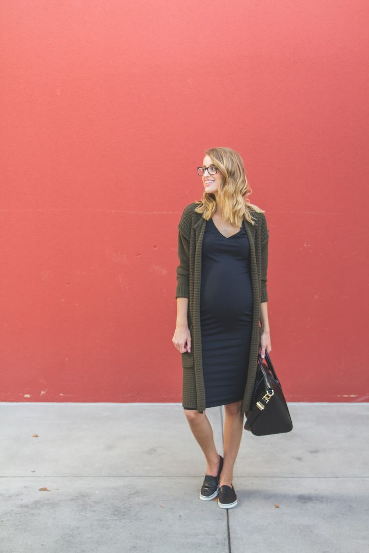 Black fitted Midi Dress. Olive long, cozy cardigan. Slip-On Sneakers