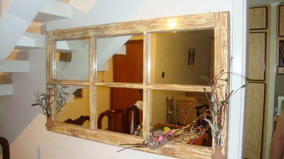 Janela antiga transformada em espelho decorativo!