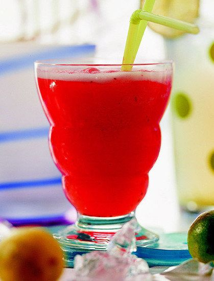 Recipe for Berry Mango Slush - Berry-flavored carbonated water and fresh summer fruits give this slushy drink recipe plenty of sweetness without adding sugar.