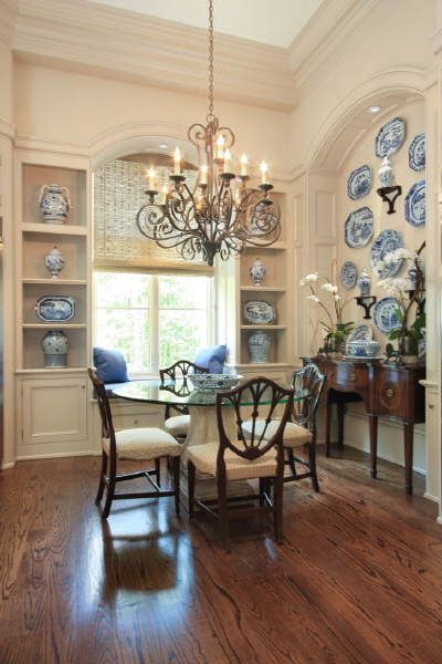 absolutely FABULOUS wall of blue and white plates... pretty traditional dining room