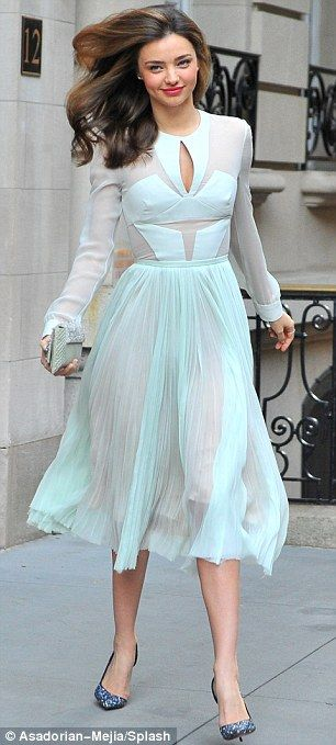 Miranda Kerr- A true heroine: The Australian model teamed her pretty frock with a pair of sparkling heels and a metallic clutch
