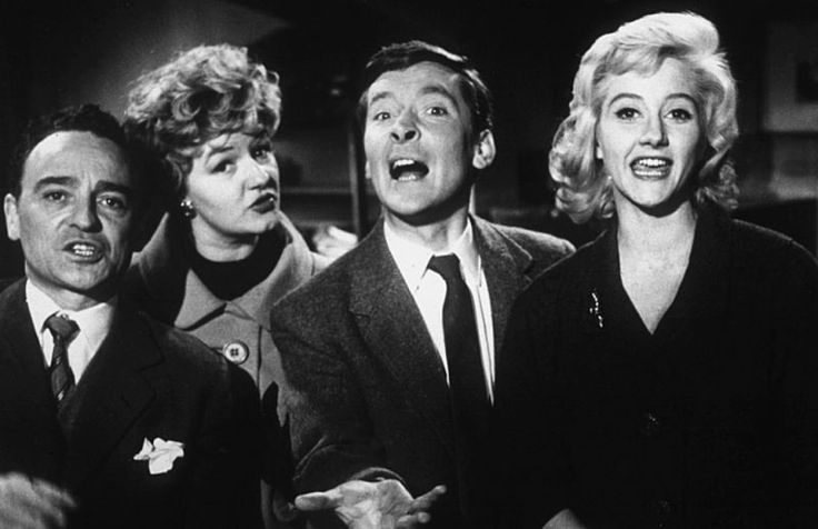 Kenneth Connor as Sam Twist, Joan Sims as Lily Duveen, Kenneth Williams as Francis Courtenay, and Liz Fraser as Delia King, in 'Carry On Regardless' (1961)