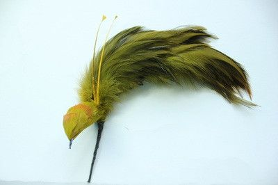 6006. Pasted bird heads with whips b/2 and hackle pompom tails b/3.