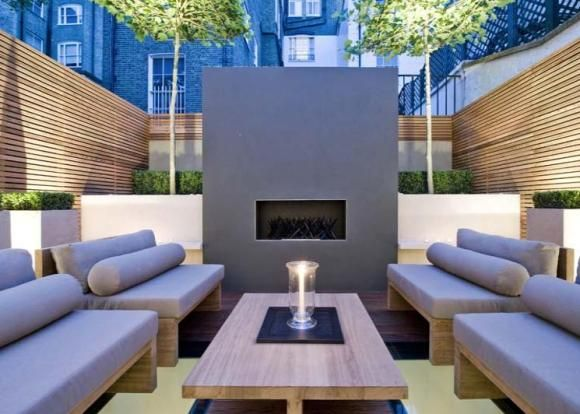 A sunken low down area can still be a fabulous outdoor living space. If that's a gas fire - make sure the gas line is on the blueprints. Wiring for the lights too!