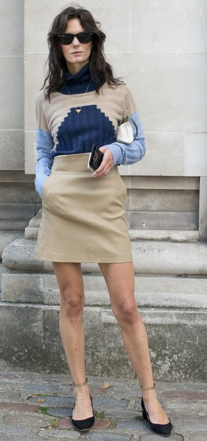 A miniskirt paired with a sweater, tucked in.