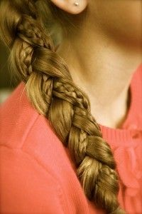 Super easy cute hairstyle . Braid a small piece of your hair and then add it in to one of the three strands in a regular braid to the side .