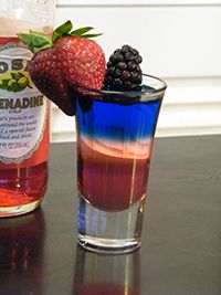 Red, White & Blue Shot    1 part grenadine  1 part peach schnapps  1 part blue curacao  Blackberry, strawberry (optional garnish)