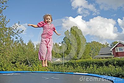 Jumping girl in the summer