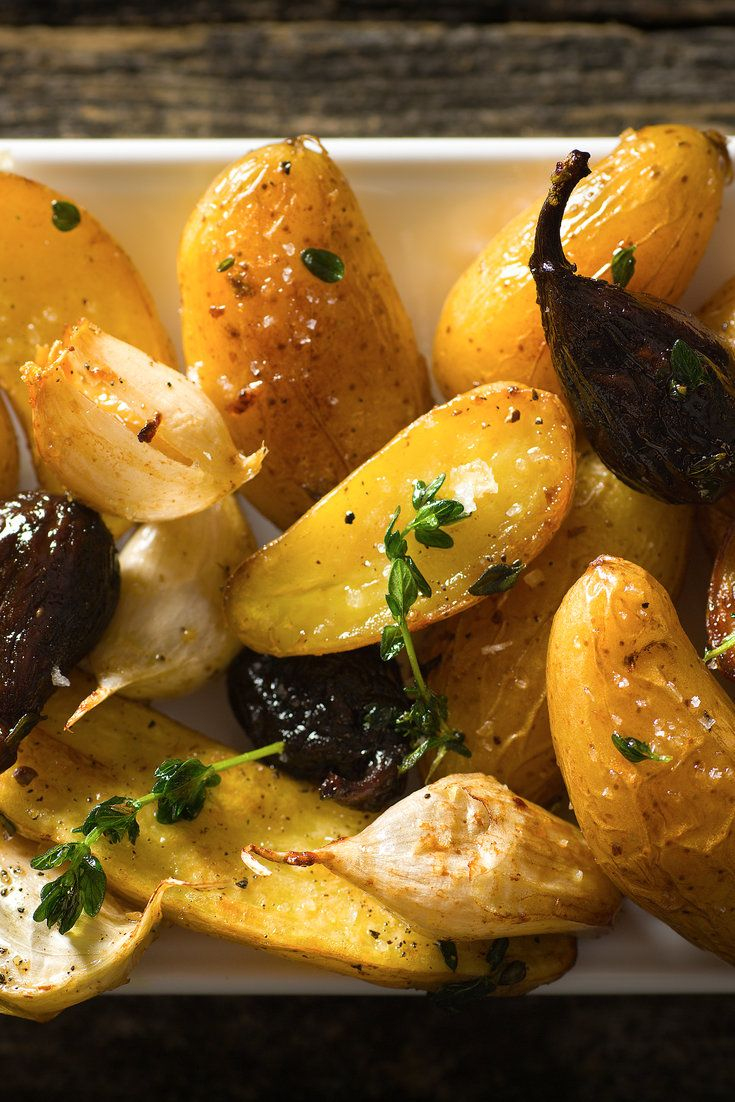 Hot black tea lends a deeper flavor to dried figs, which are scattered with potatoes on a pan with thyme and then roasted. The recipe calls for fingerling potatoes, but any waxy potato will do. (Photo: Francesco Tonelli for The New York Times)