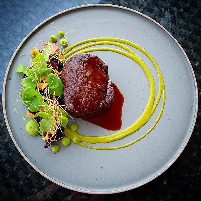 Beef, forbidden rice, king trumpet adobo, pea parsley puree, miner's lettuce, green garlic vinaigrette, garlic roots and chips  by @karloevaristo  For more Culinary inspirations join our Cookniche community. Direct link in bio.