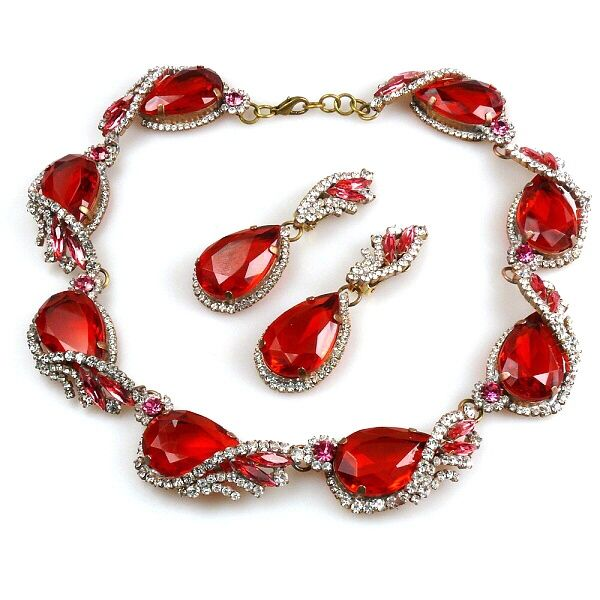 "Swan Wings Set with Earrings ~ Red with Clear Crystal. Exquisite rhinestone set designed from eight identical parts. Each part is created as three dimensional component.. Length 16.00"", extension 1.00"",earrings with clips 3.20"". Price: $129.90"