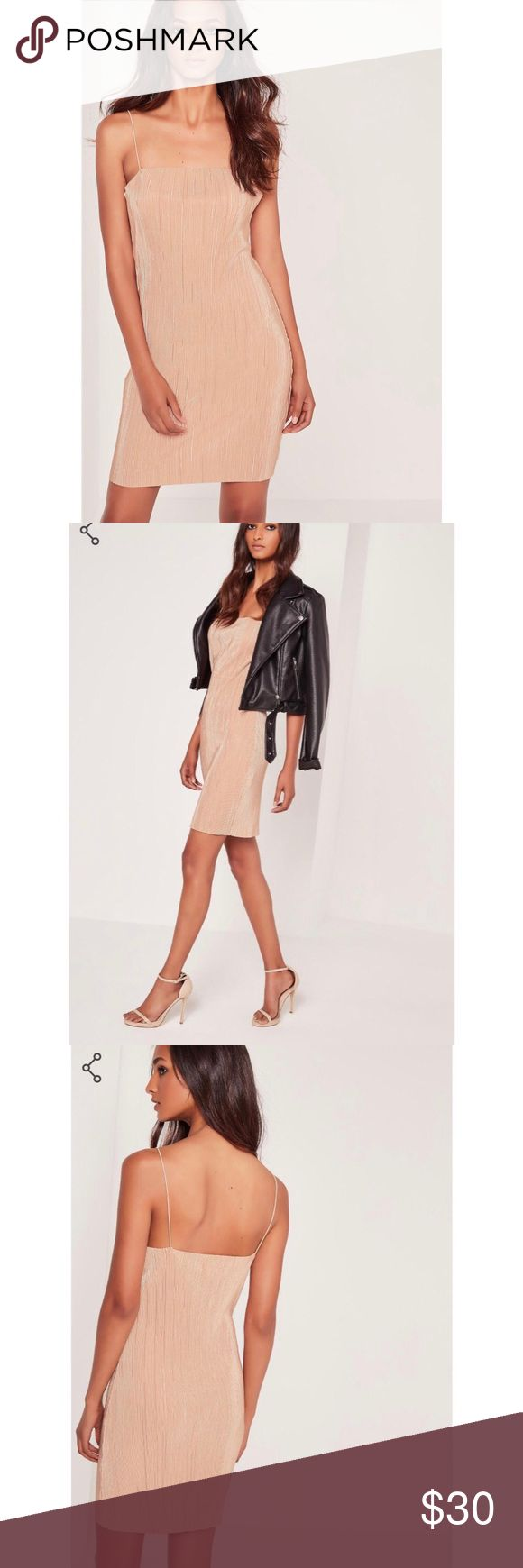 Missguided strappy pleated nude mini dress Missguided strappy nude pleated dress. Very comfortable. The shape of the dress is more like a shift dress. Size 4 which is an XS/S. Missguided Dresses