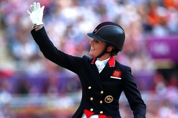 Aug 9 Charlotte Dujardin riding Valegro celebrates winning gold