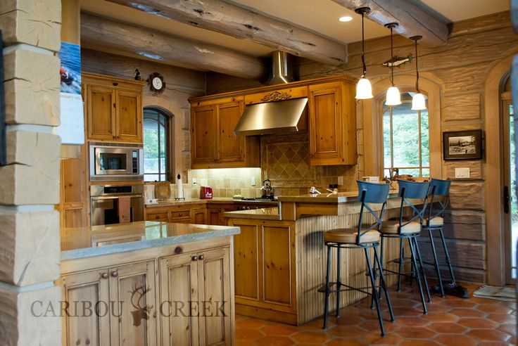 Handcrafted Gray Dovetail Log Kitchen