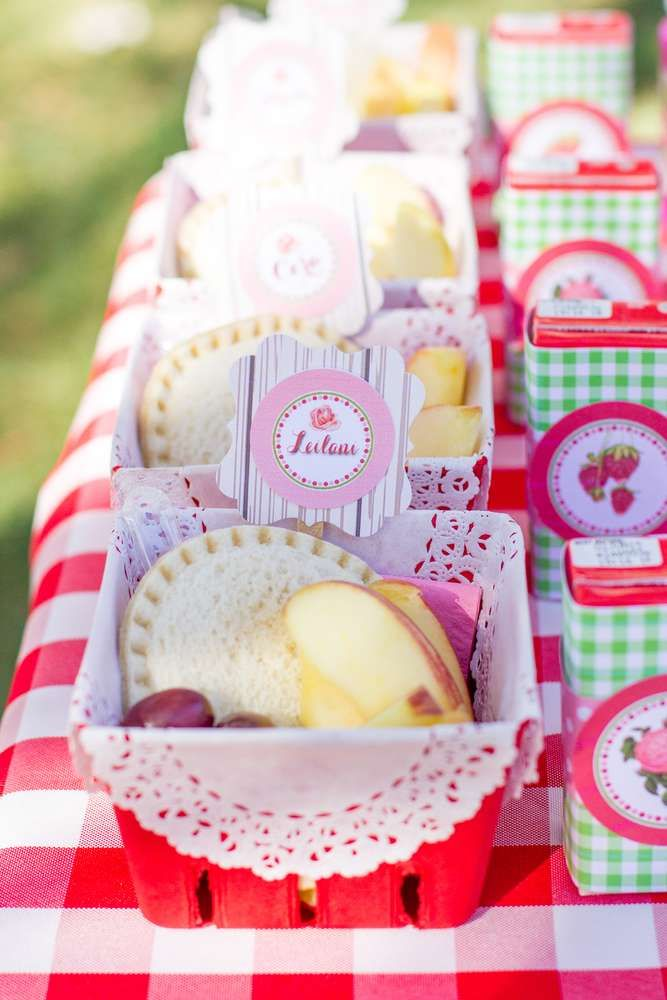 Lunches at a strawberry picnic birthday party!  See more party planning ideas at CatchMyParty.com!
